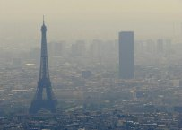 An aerial picture taken aboard an helicopter on July 20, 2010 shows a smoggy view of the Eiffel tower (L) and the Tour Maine-Montparnasse in Paris. AFP PHOTO BORIS HORVAT